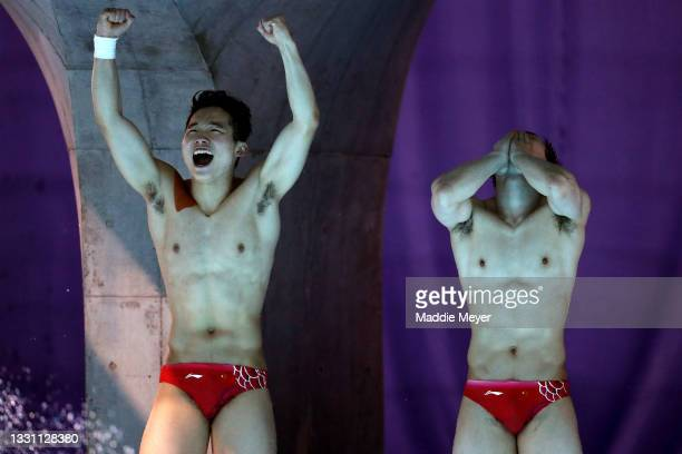 Zongyuan Wang and Siyi Xie of Team China celebrate winning gold during the Men's Synchronised 3m Springboard final on day five of the Tokyo 2020...
