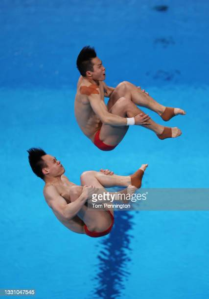 Zongyuan Wang and Siyi Xie of Team China compete during the Men's Synchronised 3m Springboard final on day five of the Tokyo 2020 Olympic Games at...