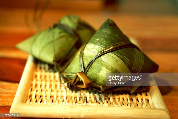 zongzi, chinese rice dumplings - dragon boat festival stock pictures, royalty-free photos & images