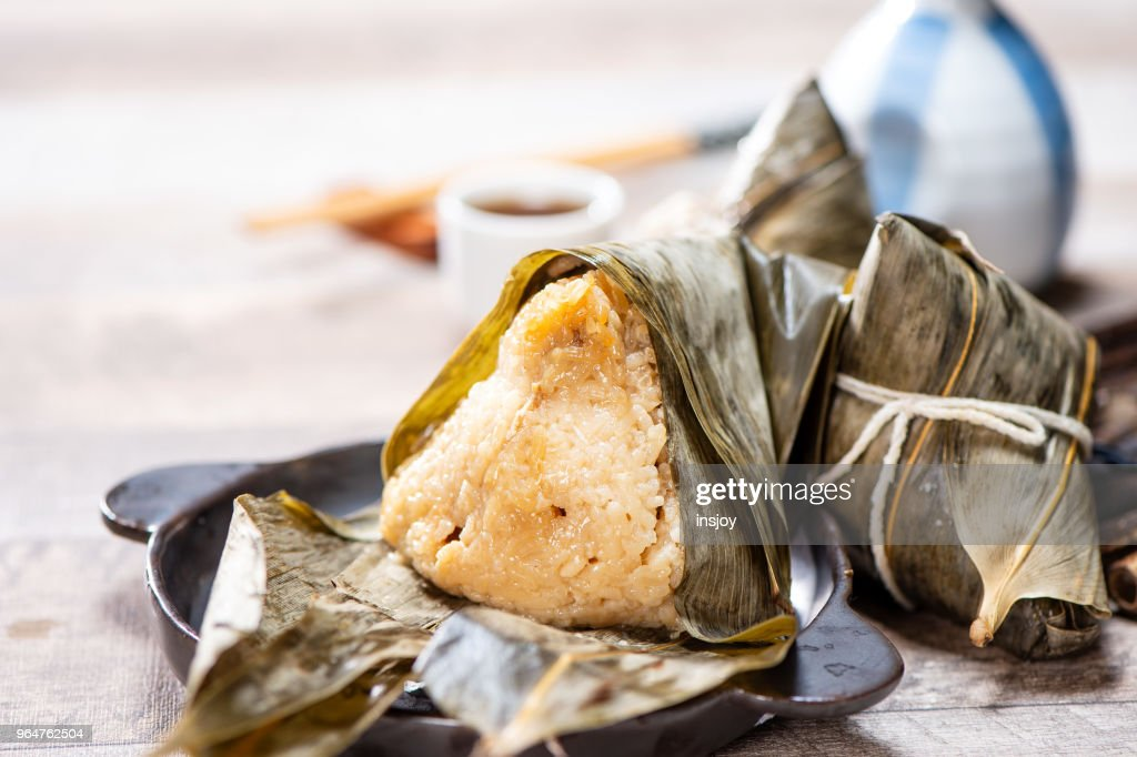 zongzi(rice dumpling) with a cup of tea on a wood table, Dragon Boat Festival, Asian traditional food, Chinese : Stock Photo