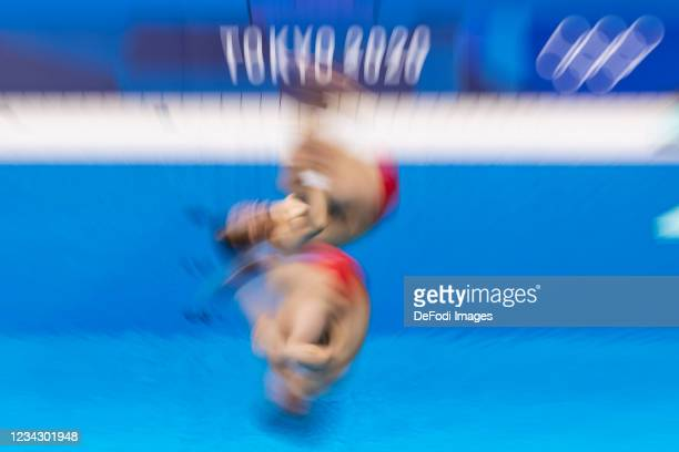 Zongzuan Wang of China and Siyi Xie of China compete during the Men's Synchronised 3m Springboard Final on day five of the Tokyo 2020 Olympic Games...