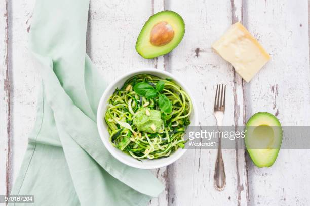 zoodels with avocado basil pesto - marrow squash stock pictures, royalty-free photos & images