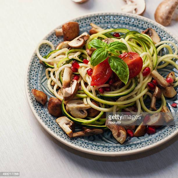 Zoodles with mushrooms and pomegranate seeds