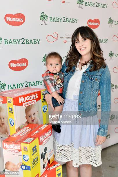 Zooey Deschanel actress and mother of two attends the Baby2Baby and Huggies No Baby Unhugged donation event to accept a 25 million diaper donation to...