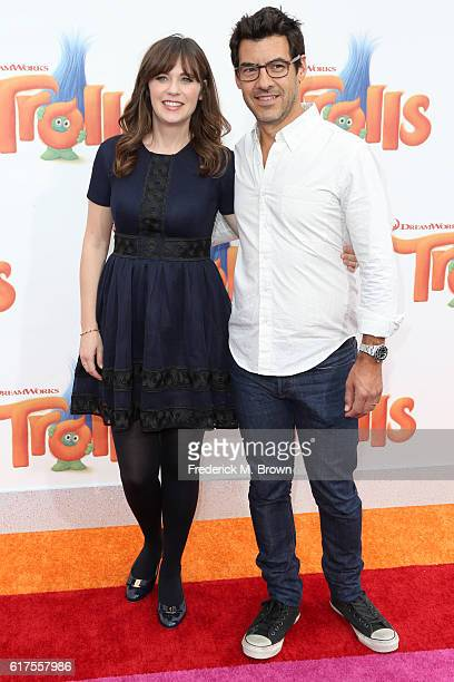 Zooey Deschanel and Jacob Pechenik attend the premiere of 20th Century Fox's Trolls at Regency Village Theatre on October 23 2016 in Westwood...