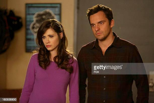 """Zooey Deschanel as 'Jess' and Jake Johnson as 'Nick' in the """"Parking Spot"""" episode of NEW GIRL airing Tuesday, February 19, 2013 on FOX."""