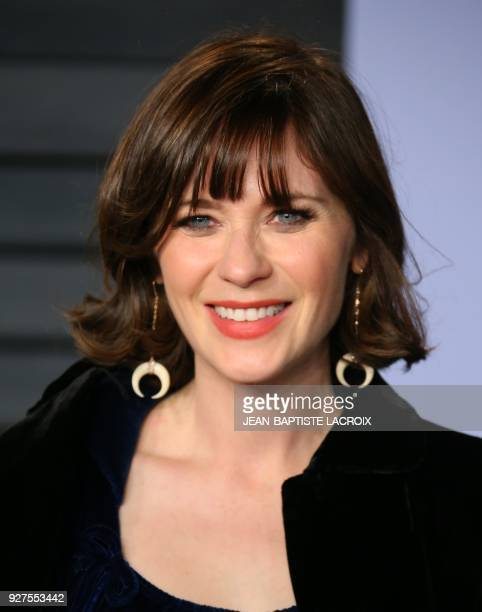 Zooey Deschanel attends the 2018 Vanity Fair Oscar Party following the 90th Academy Awards at The Wallis Annenberg Center for the Performing Arts in...