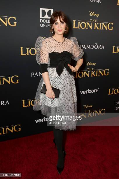 Zooey Deschanel attends the World Premiere of Disney's THE LION KING at the Dolby Theatre on July 09 2019 in Hollywood California