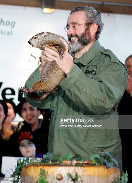 Zookeeper Douglas Schwartz pulls Staten Island Chuck from his winter home at the Staten Island Zoo early Friday morning New York's favorite Ground...