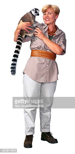 zookeeper holding a lemur - zoo keeper stock pictures, royalty-free photos & images