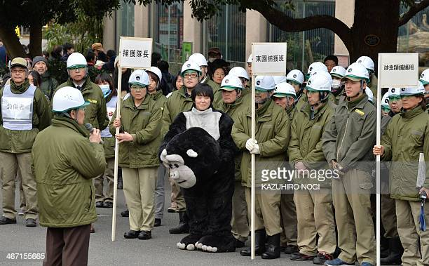 Zookeepers hold a meeting after a drill to practice what to do in the event of an animal escape at the Ueno zoo in Tokyo on February 6 2014 About 70...
