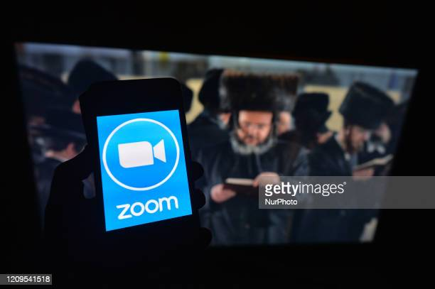 Zoom app displayed on a mobile phone Passover also known as 'Pesach in Hebrew is one of the most important festivals in the Jewish calendar and...