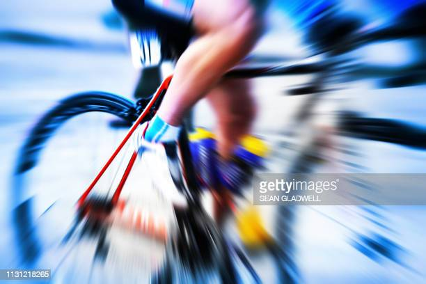 zoom blur of road race cyclist - road race stock pictures, royalty-free photos & images