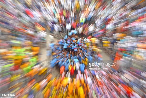 Zoom blur shot of Govindas trying to form human pyramid during Dahi Handi celebration at Ghatkopar on the occasion of Krishna Janmashtmi on August 15...