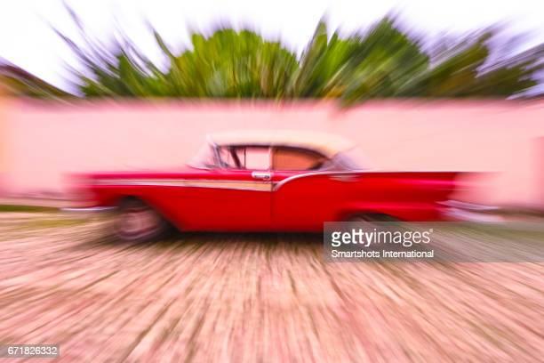 Zoom effect over red vintage car in Trinidad, Cuba