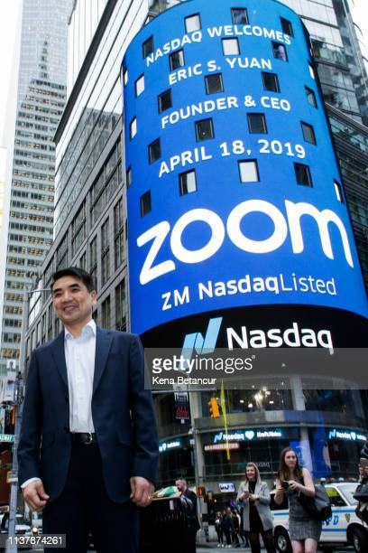 Zoom founder Eric Yuan poses in front of the Nasdaq building as the screen shows the logo of the video-conferencing software company Zoom after the...