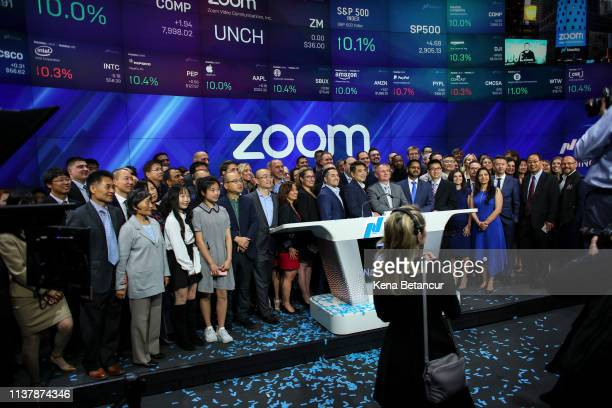 Zoom founder Eric Yuan poses with members of his team after the opening bell ceremony where the video-conferencing software company Zoom announced...
