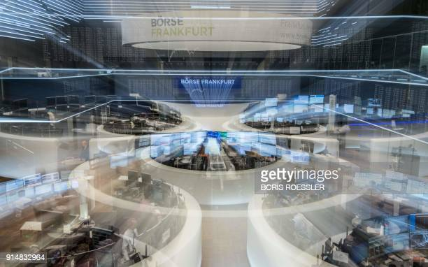 Zoom on the German stock exchange where traders work in Frankfurt am Main, western Germany, on February 6, 2018. The DAX index of blue-chip German...