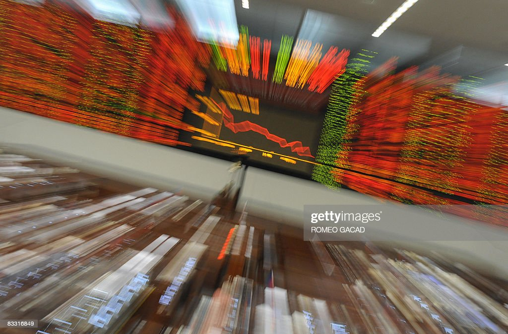 A zoom shot shows the share prices at the Philippine Stock Exchange