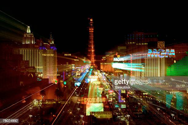 zoom streaked lights in the city of las vegas at night - las vegas boulevard stock pictures, royalty-free photos & images
