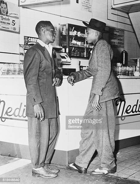6/12/1943 Zoot by any other name a patriot just the same Two men stand at a soda fountain wearing zoot suits