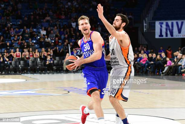 Zoran Dragic #30 of Anadolu Efes Istanbul competes with Joan Sastre #30 of Valencia Basket during the 2017/2018 Turkish Airlines EuroLeague Regular...