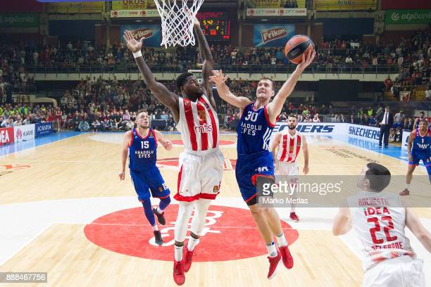 Zoran Dragic #30 of Anadolu Efes Istanbul competes with Mathias Lessort #26 of Crvena Zvezda mts Belgrade during the 2017/2018 Turkish Airlines...