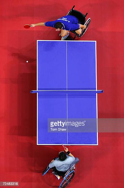 Zoran Krizanec of Croatia stretches to return a ball to Chih Jung Chang of Taipei during the Mens Individual Class 5 group match during the Athens...