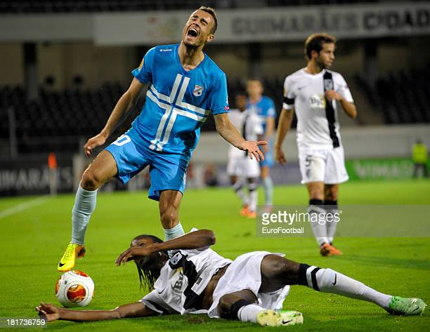 Zoran Kvrzic of HNK Rijeka is challenged by Abdoulaye Ba of Vitoria SC during the UEFA Europa League group stage match between Vitoria SC and HNK...