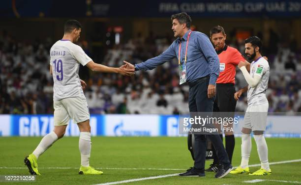 Zoran Mamic head coach of Al Ain shakes hands with Mohanad Salem of Al Ain as he is substituted during the FIFA Club World Cup first round playoff...