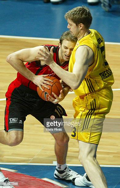 Zoran Planinic of TAU Ceramica and Hanno Mottola of Aris TT Bank in action during the Euroleague Basketball Top 16 Game 5 between Tau Ceramica and...