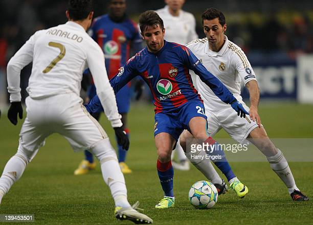 Zoran Tosic of CSKA Moscow battles for the ball with Cristiano Ronaldo and Alvaro Arbeloa of Real Madrid during the UEFA Champions League round of 16...
