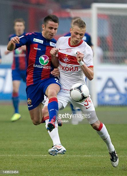 Zoran Tosic of PFC CSKA Moscow battles for the ball with Evgeni Makeev of FC Spartak Moscow during the Russian Football League Championship match...