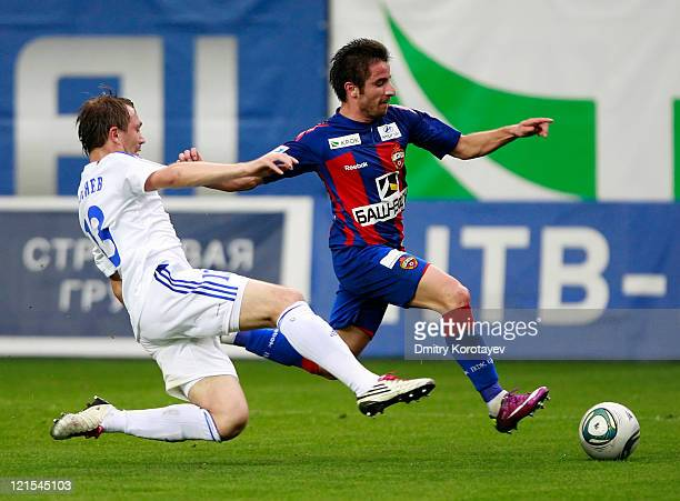 Zoran Tosic of PFC CSKA Moscow battles for the ball with Ilya Gultyayev of FC Tom Tomsk during the Russian Football League Championship match between...