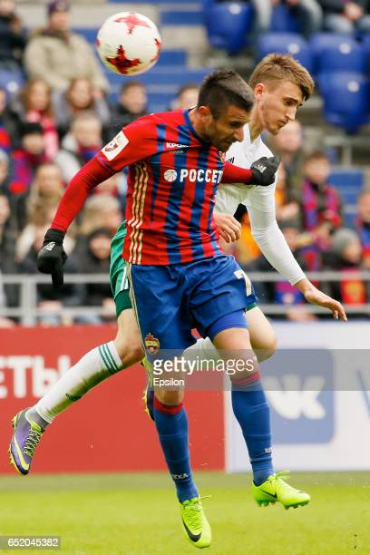 Zoran Tosic of PFC CSKA Moscow challenged by Dmitry Sasin of FC Tom Tomsk during the Russian Premier League match between PFC CSKA Moscow and FC Tom...