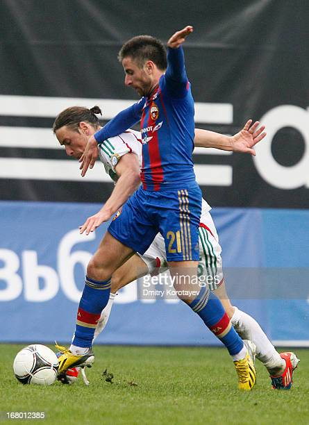 Zoran Tosic of PFC CSKA Moscow is challenged by Igor Lebedenko of FC Terek Grozny during the Russian Premier League match between PFC CSKA Moscow and...