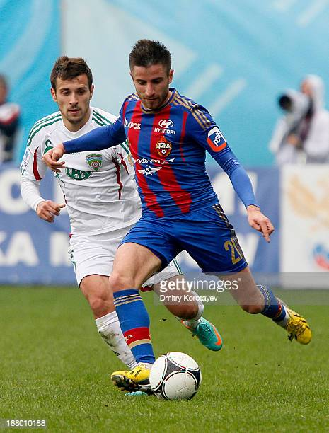 Zoran Tosic of PFC CSKA Moscow is challenged by Maciej Makuszewski of FC Terek Grozny during the Russian Premier League match between PFC CSKA Moscow...