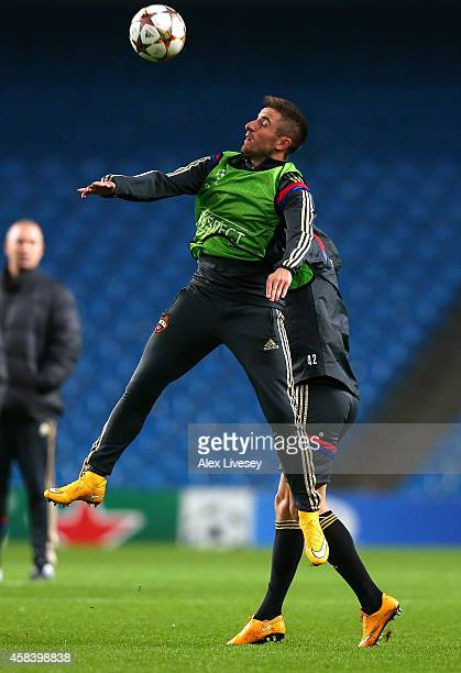 Zoran Tosic of PFC CSKA Moskva jumps for a high ball during a training session press conference at the Etihad Stadium on November 4 2014 in...