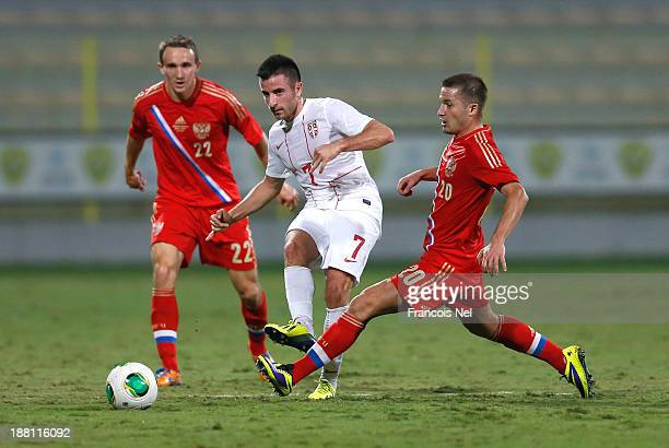 Zoran Tosic of Serbia fight for the ball with Alexey Kozlov of Russia and Victor Fayzulin of Russia during the International Football match between...