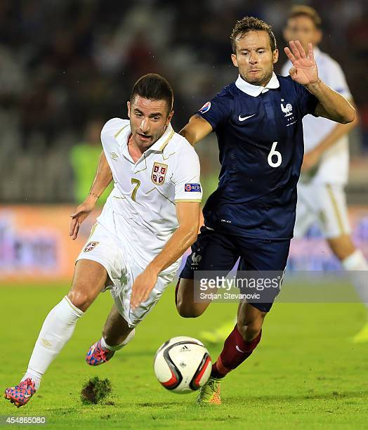 Zoran Tosic of Serbia is challenged by Yohan Cabaye of France during the International friendly match between Serbia and France at the Stadium JNA on...
