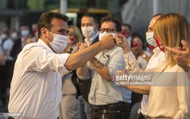 Zoran Zaev leader of the ruling SDSM party greets supporters during an election campaign rally in Skopje on July 10 2020 North Macedonia's main...