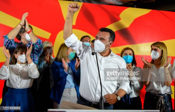 Zoran Zaev, leader of the ruling SDSM party, wears a facemask as he celebrates victory during general elections in Skopje early on July 16, 2020. -...