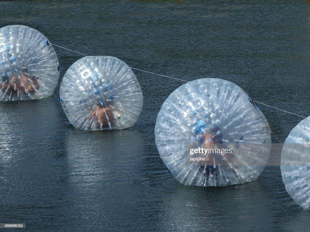 Zorbing on water : Stock Photo
