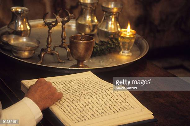 Zoroastrian Mobed reads from the Sanskrit text of the Zoroastrian holy book, or Avesta, during a Gahanbar thanksgiving ceremony at the Rostam Bagh...