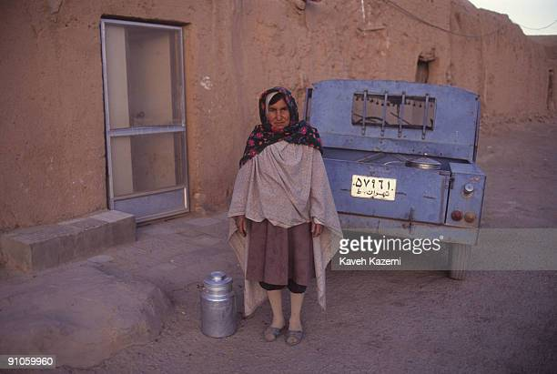 A Zoroastrian woman in traditional dress stands outside a mudbrick house in the village of Zeinabad near Yazd Iran 1st October 1995 Most villages...