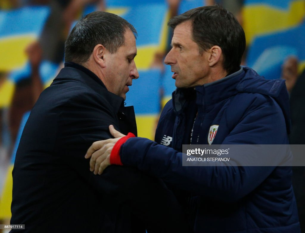 Zorya's head coach Iurii Vernydub (L) and Athletic head coach Jose Angel Ziganda embrace after the UEFA Europa League Group J football match between Zorya Luhansk and Athletic Bilbao in Lviv on December 7, 2017. /