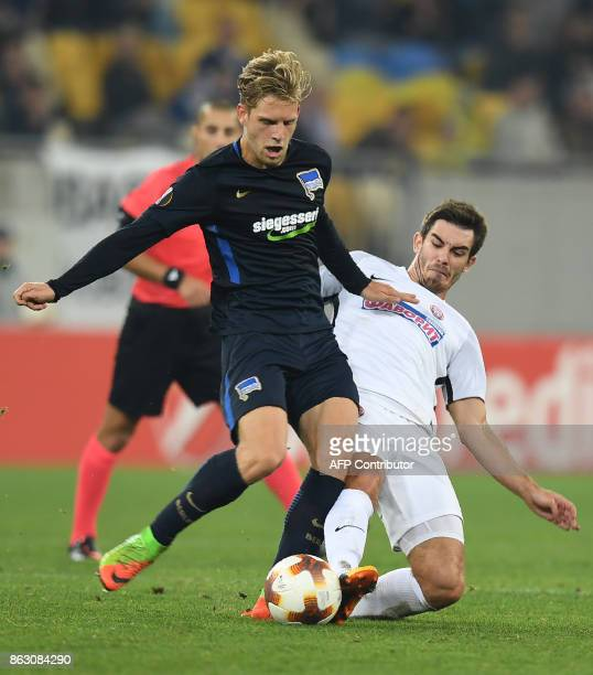 Zorya's Ihor Kharatin vies with Hertha BSC Berlin's Arne Maier during their UEFA Europa League Group J football match FC Zorya Luhansk and Hertha BSC...