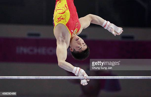 Zou Kai of China reacts in the Men's Apparatus Final during the 2014 Asian Games at Namdong Gymnasium on September 25, 2014 in Incheon, South Korea.