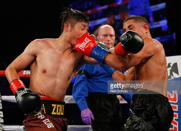 Zou Shiming left and Jozsef Ajtai exchange punches in their Flyweight Championship bout on June 11 2016 at the Theater at Madison Square Garden in...
