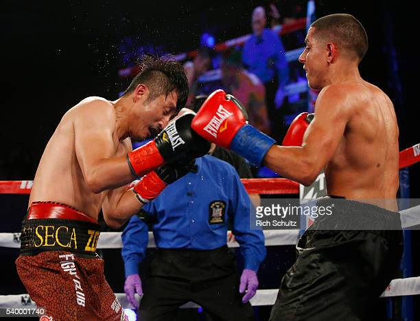 Zou Shiming left and Jozsef Ajtai in action in their Flyweight Championship bout on June 11 2016 at the Theater at Madison Square Garden in New York...